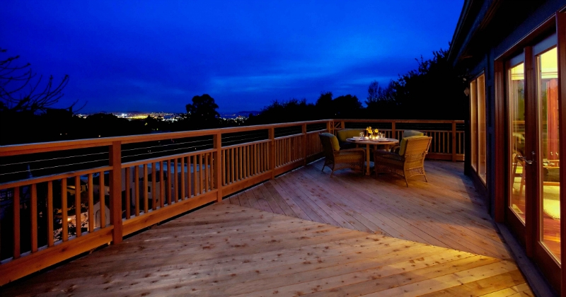 Deck at night with San Francisco in the background